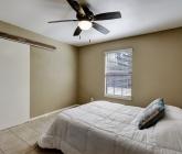 Bedroom features a walk-in closet